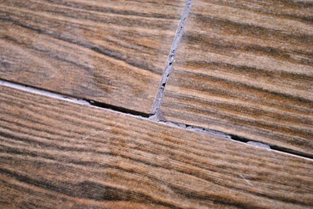 Cracking grout on wood look tile