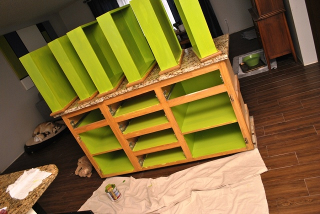 First coat of paint on cabinets and drawers