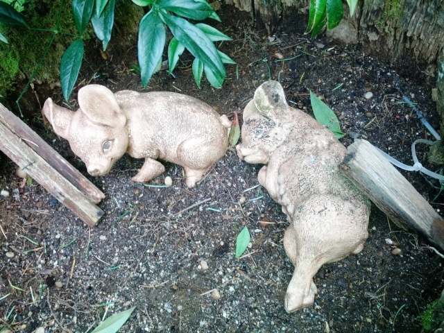 Creepy piglet yard art
