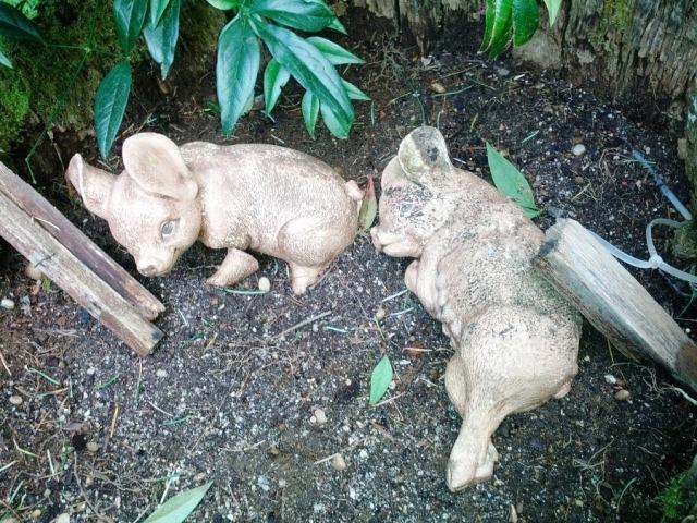 Creepy piglet yard art