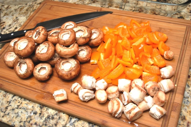 prepping mushrooms and bell peppers for the grill