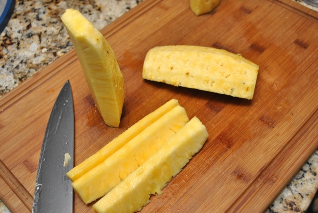 cutting up pineapple