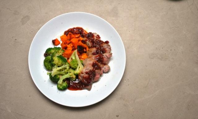 Pan-Seared Pork Tenderloin with Roast Squash, Steamed Broccoli, and Cranberry Glaze
