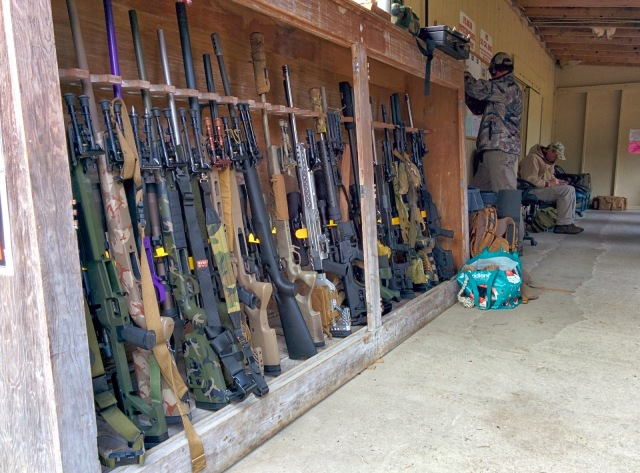 Rifles all lined up in a rack