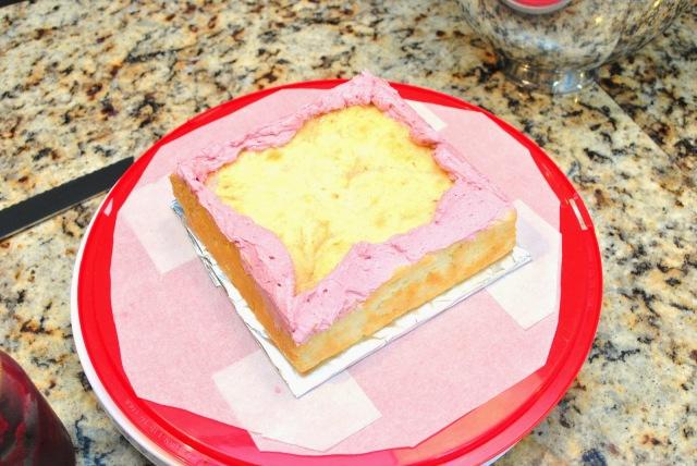 assembling lemon-raspberry layer cake