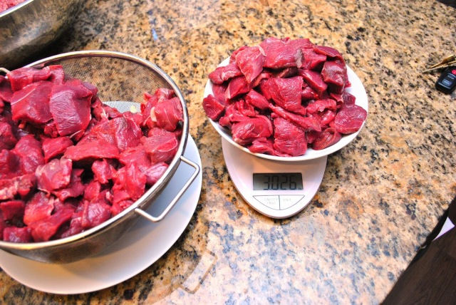weighing out venison chunks